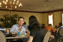 Rev. Dr. Aquilez Martinez and a student at the Gordy Center Cafeteria.