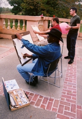 Professor Davis instructs Watercolor class on the patio of the Fincher Art Building