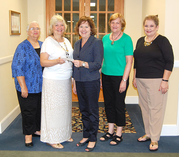 Teachers of the past help teachers of the future! The Cherokee Retired Educators Association presented Reinhardt with a $2,000 check to provide scholarships for students majoring in education. Dr. Kina Mallard, Reinhardt president (center), accepted the generous donation from Marlene Harrington, CREA president, along with Karen Hawley (from right), president-elect; Kathy Brown, membership officer; and Jean Cantrell, treasurer.
