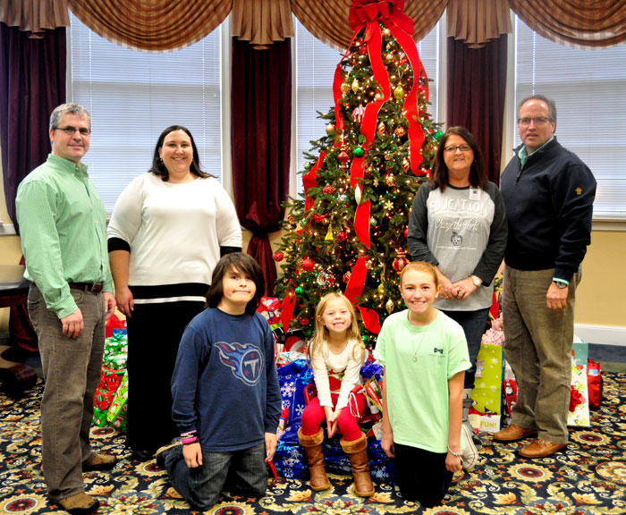 Giving Tree organizers and school representatives included (from left): Mr. Jon Costales, Counselor, Janna Moore, Quin Costales, 5th Grade, Emma Kate Townsend, Pre-K, Juliana Brown, 5th Grade, Dottie Townsend, RM Moore Secretary, and Tim Norton, VP of Advancement and Marketing.