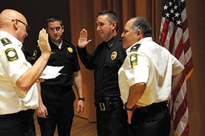 After receiving peace officer certification through P.O.S.T. from the Reinhardt University Police Academy, Officer Matt Akins gets sworn in as a police officer for Carver College Police Department.