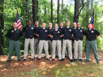 Front row, from left, Matthew Walker, Brandyn Smith, Devon Holobach, Leon Lancaster and Mushtaba Siddiqui; and back row, from left: Joel Smith, Marcus Lamb, Gary Elliott and Scott Nielsen. Jose Marrero is not pictured. Police Academy Director Trey Drawdy is pictured at left, and Capt. Jeff Black is pictured at right.