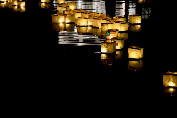 Decorated lanterns floating on the lake at night.