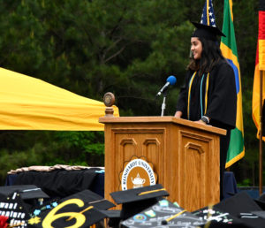 Angel Cornista addresses students at commencement.