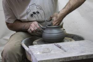 Greek artists creates a ceramic vase